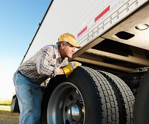 guy-checking-truck