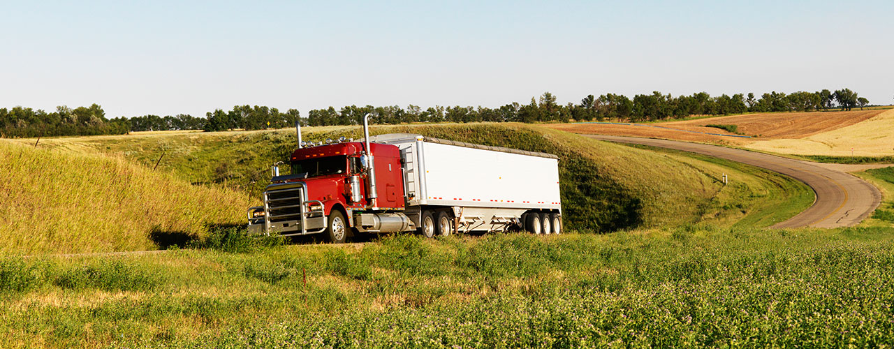 red-truck-driving-through-fields